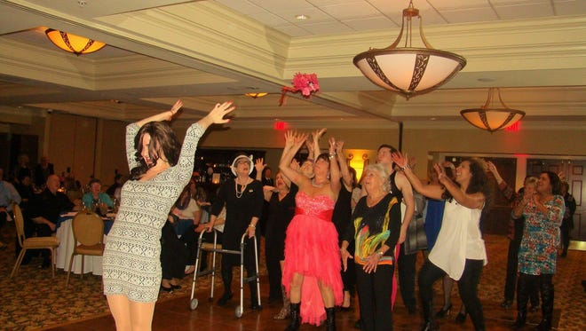 """A scene from """"Joey and Gina's Italian Comedy Wedding"""" from Ovation Dinner Theatre in 2015. The show returns to the Wicomico Youth & Civic Center on June 10."""