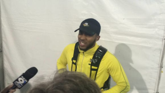Oregon's Kyree King talks to the media after placing