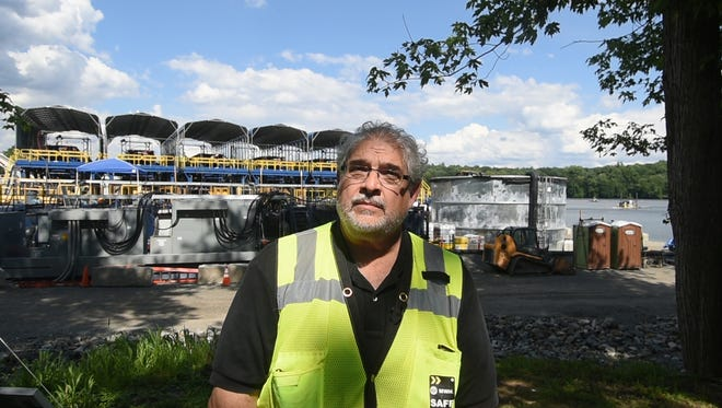 Perry Katz, EPA Region 2 project manager, in front of a processing station at Pompton Lake that removes contaminated sediment from the lake bottom. The sediment has mercury and other contaminants from the former DuPont munitions site nearby.