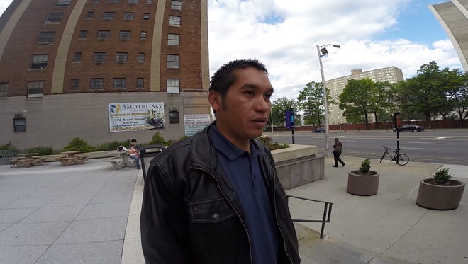 Carlos Larios, 31, of Long Branch waits outside of the Peter W. Rodino Federal Building n Newark before his check-in with immigration authorities in June.