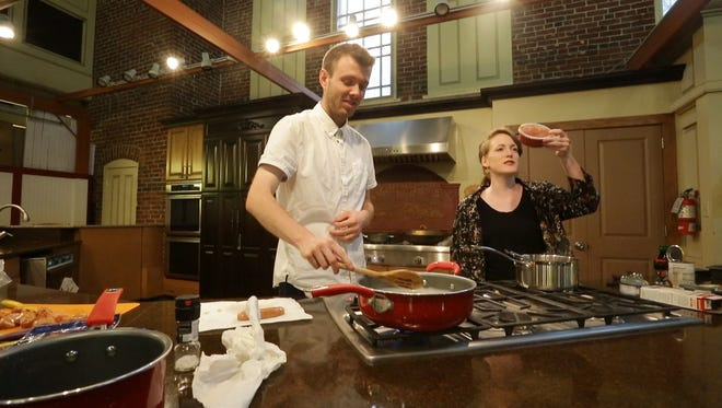 Hamilton County reporter Andrew Clark and Neighborhoods reporter Ruth Serven participate in a cooking challenge at City Market on July 7, 2017.