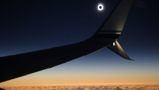 Science teacher Lindsay Adams captured the 2016 solar eclipse while flying over the Pacific Ocean