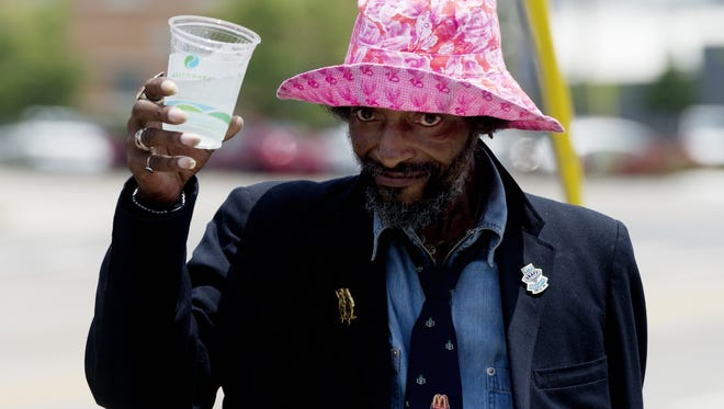 A homeless man thanks the group for the cup of water during the Win Our World (WOW) Urban Ministry program at St. John's Lutheran Church during a water handout along Broadway in Knoxville, Tennessee on Thursday, July 20, 2017.