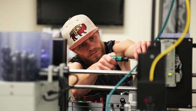 Student Zach Bloem troubleshoots a machine as part of the Panasonic Preferred Pathway training program at Truckee Meadows Community College's William N. Pennington Applied Technology Center on July 25, 2017. Bloem came all the way from Susanville, Calif., to train for a Tesla Gigafactory job.