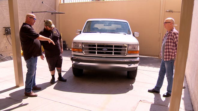 'Pawn Stars' regulars Rick Harrison, left, and Chumlee Russell inspect the Ford Bronco driven in the 1994 slow-speed chase of O.J. Simpson.