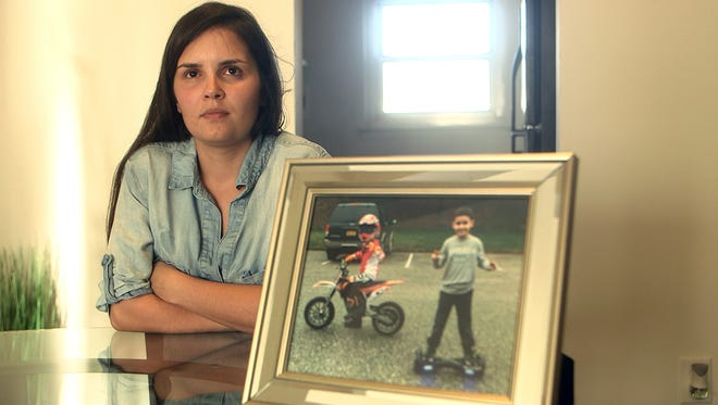 Vivane Ferreira Leite, 29, of Ocean, a Brazilian native. Her kids were abducted by the father and taken to Brazil. Christyan is 9 and Gabriel is 7.