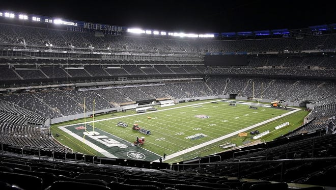 The operations crew at MetLife Stadium changes the endzones from the New York Giants logo to the New York Jets logo during an overnight flip of the stadium on Friday, August 11, 2017. The Giants hosted the Steelers for a preseason game on Friday 7pm, and the Jets will host the Titans at 7:30pm on Saturday.