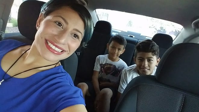 Velasquez with her sons, Robert (8) and Jorge (11).