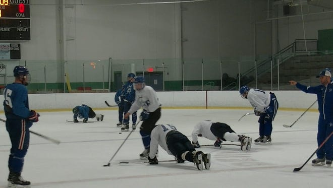 Jared Kersner, far right, instructs Skipjacks Hockey Club players during their first practice of the season at York City Ice Arena in August. Kersner coaches the 18-and-under midget hockey team for the Skipjacks.