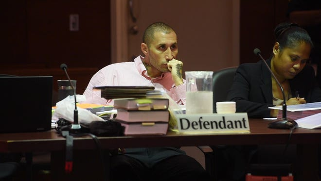 In this Sept. 14 file photo, defendant Allan Agababa listens to testimony by Guam's Chief Medical Examiner Dr. Aurelio Espinola on the fourth day of his trial at the Superior Court of Guam.