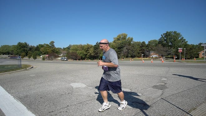 Ron runs the recent Brooksie Way half-marathon, a 13.1-mile race that starts and ends on the grounds of the Meadow Brook amphitheater.