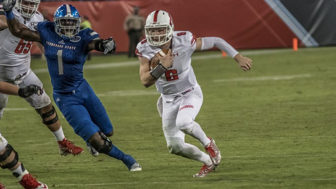 Austin Peay quarterback Jeremiah Oatsvall rushes against Tennessee State.