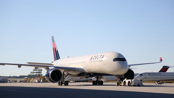 A Delta Airbus A350 is towed to a hangar in Atlanta after a demonstration flight over the U.S. Southeast on Tuesday, Oct. 17, 2017.