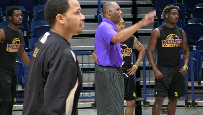 Earl Taylor, center, is embarking on a new opportunity as an assistant coach at Miles College.