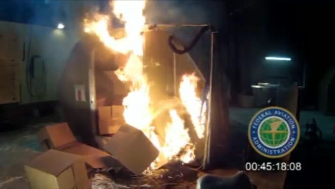 An April 2014 file image frame grab from video, provided by the Federal Aviation Administration (FAA), from a test at the FAAs technical center in Atlantic City, N.J. The U.S. government is urging that large, personal electronic devices like laptops be banned from airline checked luggage because of the potential for a catastrophic fire.