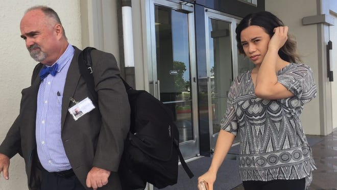 In this Oct. 2017 file photo, Attorney Curtis Van de veld and Sue Ann Baker leave the District Court of Guam in Hagåtña after Baker's sentencing was postponed. Baker is charged in connection with one of the largest methamphetamine seizure's in the island's history.