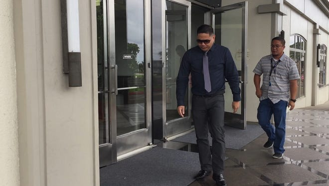 Glenn Mac Santos Felix, left, leaves the District Court of Guam in Hagåtña on Wednesday Oct. 25, 2017 after he was sentenced to more than 5 years in prison for methamphetamine he tried to bring into Guam.