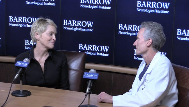 Barrow Neurological Institute President and CEO Michael Lawton, right, unveiled expansion plans during a news conference introducing him as the research center's new leader. A former patient, actress Sharon Stone, joined him at the event.