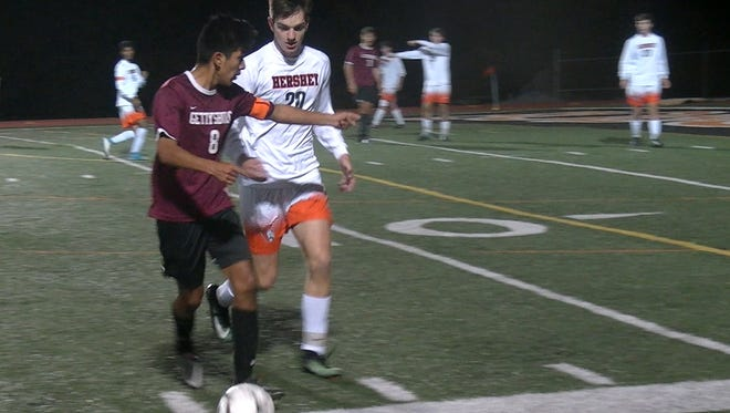 Gettysburg's Fernando Carrillo directs a teammate as he dribbles the ball down the touch line as Hershey's Dante Falcucci defends Thursday, Oct. 26, 2017.