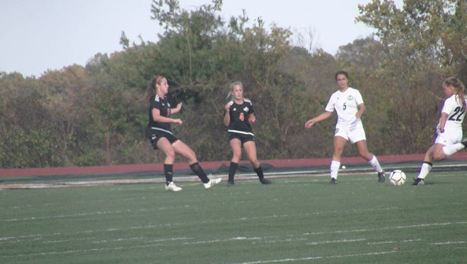Central York girls' soccer tries to defend Central Dauphin's Alyssa Mayberry in the Class 4A quarterfinals on Saturday.