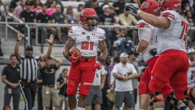 Austin Peay running back Ahmaad Tanner celebrates with his team after scoring a touchdown vs. Central Florida.