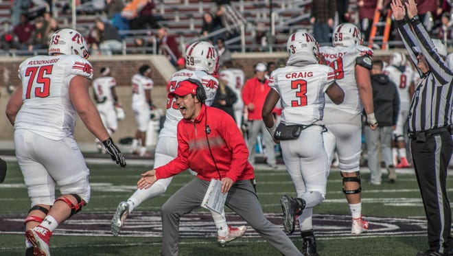 Austin Peay head coach Will Healy celebrates the team's game-winning drive in a 31-24 win over Eastern Kentucky Saturday, Nov. 11 in Richmond, Ky.