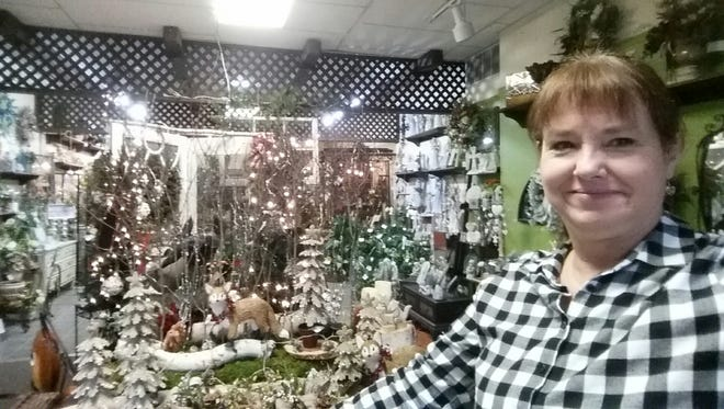 Annie Burnham, an employee at The Village Florist in downtown Milford takes a selfie.