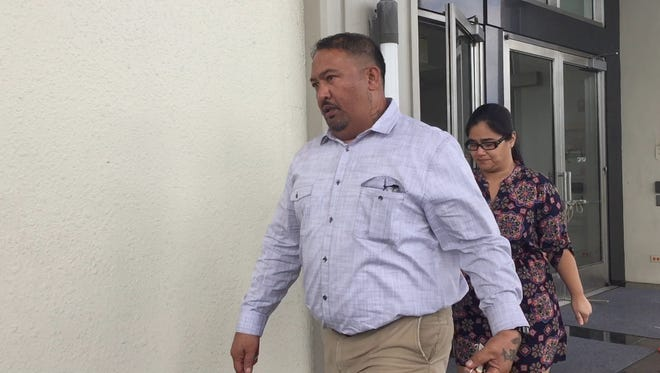 Gilbert Salas Duenas Jr., left, leaves the District Court of Guam in Hagåtña on Dec. 4, 2017 after he was sentenced to time served and two years home detention. Duenas in 2011 picked up letters that contained methamphetamine in the mail.