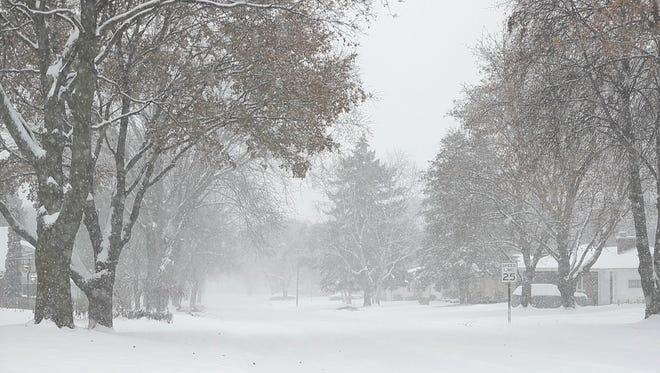 Snow falls in Allouez, Wis. on Dec. 13, 2017.