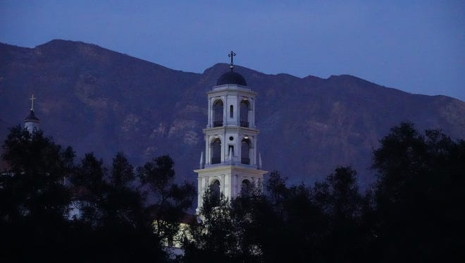 The bell tower at Thomas Aquinas College Saturday evening as seen from Highway 150 outside Santa Paula, near where the Thomas Fire started Dec. 4. Geographic landmarks often provide a fire's name, as happened with the private Catholic campus set amid rural hills.