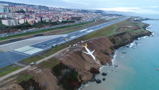 A Boeing 737-800 passenger plane of Pegasus Airlines sits on a cliff after going off the runway at Trabzon Airport in Trabzon, Turkey, on Jan. 14,  2018.