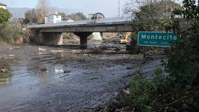In this file photo, Highway 101 is shown under mud and water after the Montecito mudslides.