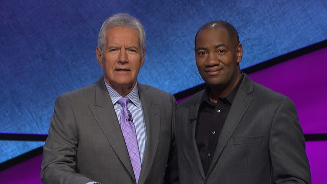 "Milwaukee native Gilbert Collins (right) won five consecutive games on ""Jeopardy!"" hosted by Alex Trebek."