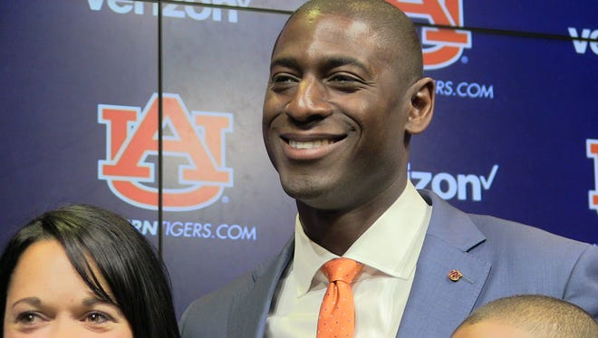 Allen Greene becomes the first African-American athletic director at Auburn University.