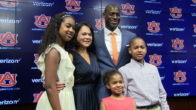 New Auburn athletic director Allen Greene takes a photo  with wife Christy, son Samuel and daughters Rian and Seneca.