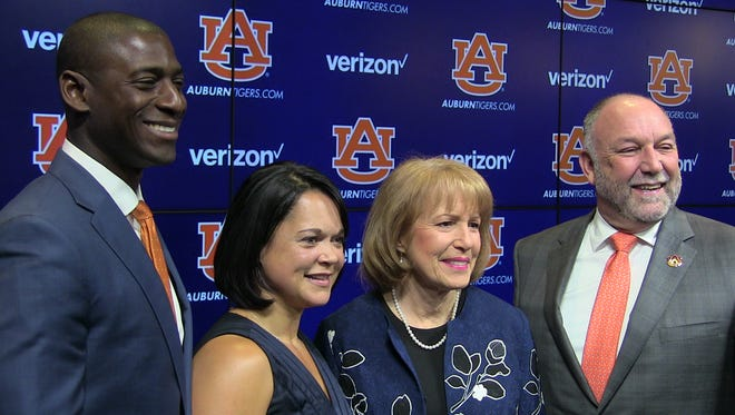 Allen and Christy Greene smile with Auburn president Steven Leath and his wife, Janet.