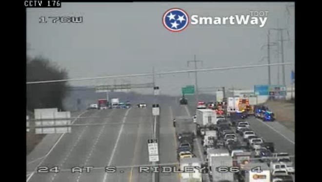 A multi-vehicle crash on I-24 has shut down traffic in both directions as emergency crews work the area.
