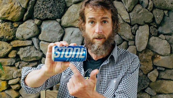 Greg Koch, co-founder and executive chairman of Stone Brewing Co., showing a Keystone Light can. Stone is suing MillerCoors, charging the megabrewer's rebranding of Keystone Light co-opts the Stone brand and confuses consumers.