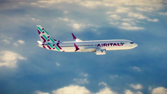 This image, provided by Qatar Airways, shows a Boeing 737 Max in the new colors and paint scheme for Air Italy