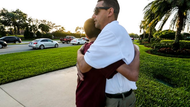 Brandon Travinski, 14, met his dad along this road the day of the shooting after a long string of texts. On Wednesday morning Robert Travinski wanted to walk him to school. Brandon told his dad he could do it himself. Robert Travinski hugged him on the corner and let him walk the rest of the way on his own. Brandon Travinski was ready to head back to school Wednesday morning. He wanted to be with his classmates, even though he knew it would be a hard day to get through. Both his parents gave him a hug before he walked to school with his cellphone and a water bottle. Brandon Travinski was on the third floor of the freshman building during the shooting. Stoneman Douglas High School students headed back to campus for their first day of class since the Feb. 14 shooting that took the lives of 17 of their classmates and teachers. It was an emotional day for them, but most were glad to be back.