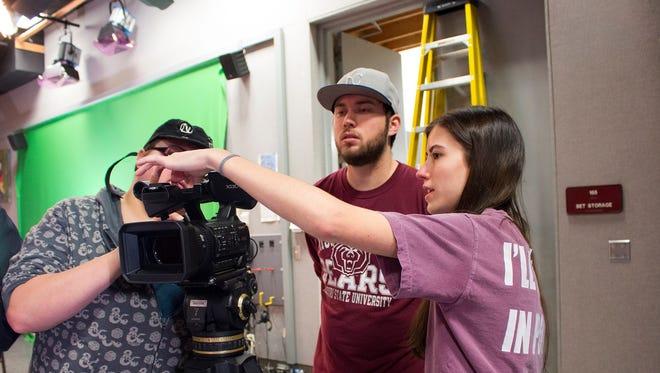 Mariah Zenk demonstrates camera technique during a Missouri State University film class.