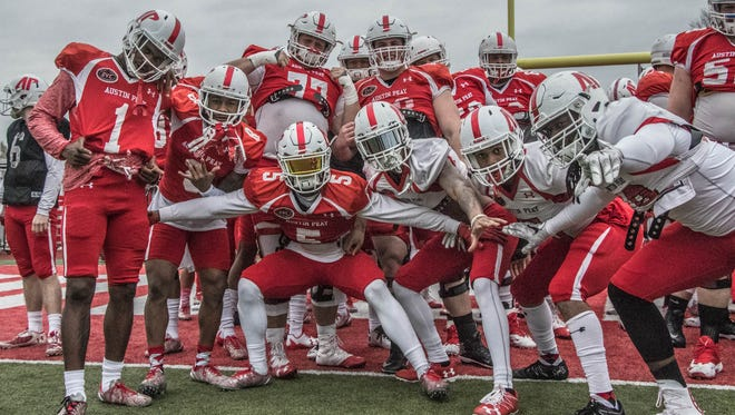 Austin Peay football players strike a pose during the team's final practice of the spring.