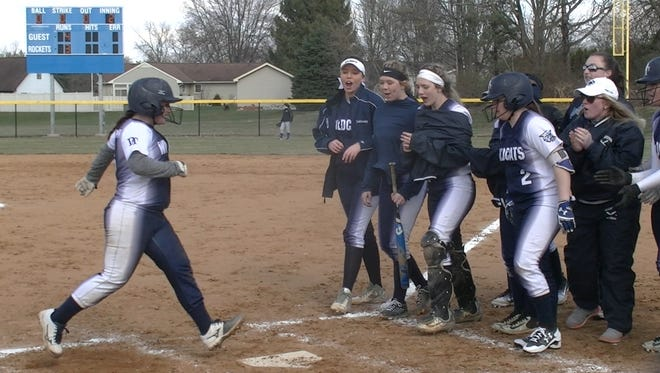 Dallastown's Hannah Pierce is greeted by teammates after hitting a three-run home run in the second inning of Dallastown's 18-15 victory against Spring Grove Thursday, April 5, 2018.