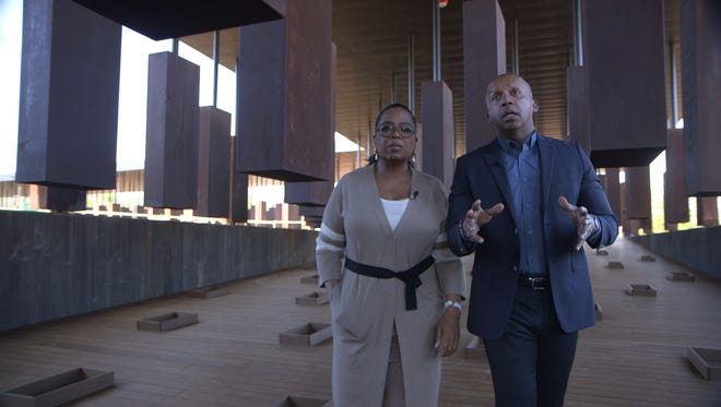 Oprah Winfrey, left, tours the Equal Justice Initiative's new memorial to lynching victims with EJI founder Bryan Stevenson.