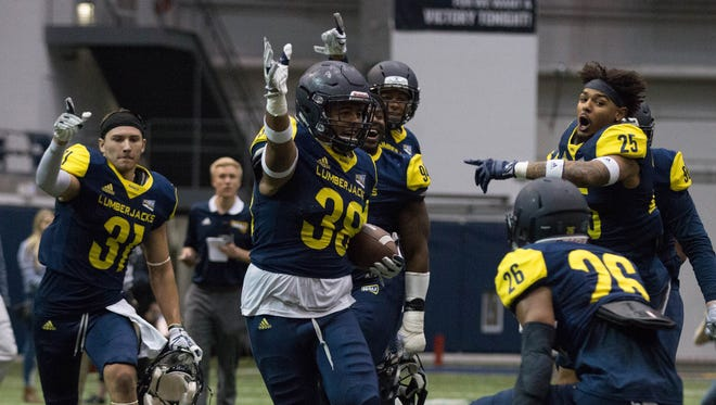 NAU linebacker Taylor Powell celebrates a turnover at the spring game on Saturday, April 21, 2018, in Flagstaff. Powell is one of 48 NAU players who went to an Arizona high school.