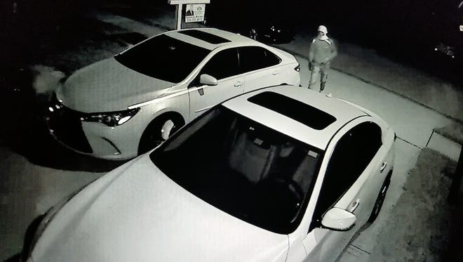 Surveillance footage shows suspects with covered faces checking for unlocked cars in a Cocoa neighborhood.