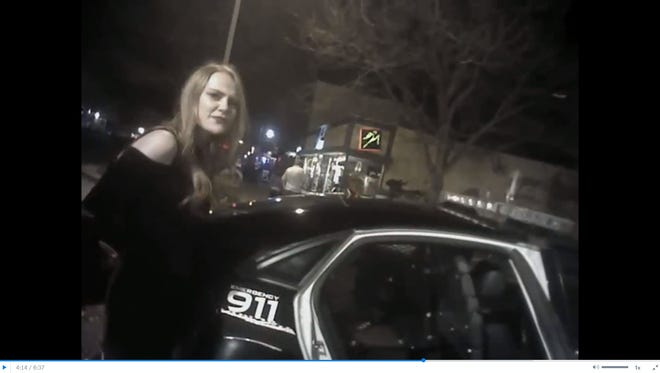 Michaella Surat is seen in this video still from a Fort Collins police officer's body camera on the night of her arrest in April 2017. Surat's defense attorney released footage from one body camera capturing the incident this week.