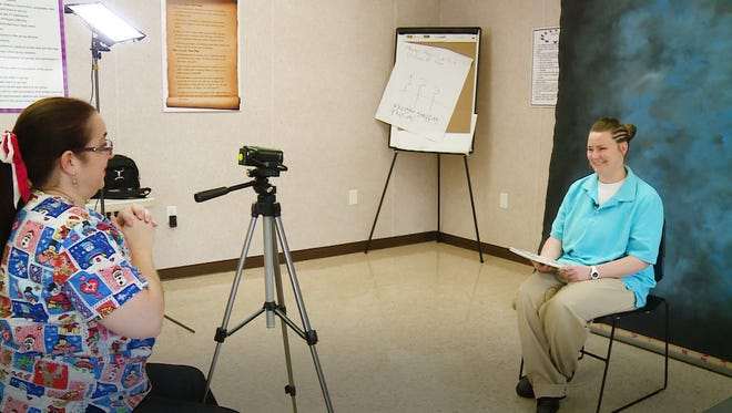Anne Van Pelt sits down to begin her recorded reading session for her 10-year-old daughter.