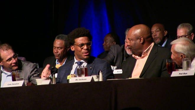 Auburn coach Gus Malzahn, Heisman Trophy winners Cam Newton, Bo Jackson and former Auburn coach Pat Dye talk during the Jimmy Rane Foundation banquet Thursday night in Montgomery.