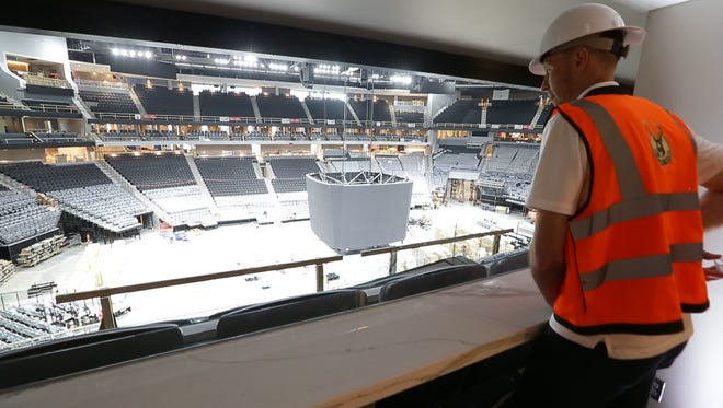 """Former Marquette and Bucks forward Steve Novak looks out from Suite 13 in the new Bucks arena. """"When you come and watch a game, you know that you've been given the best possible angle ... which I think is cool as a player and as a fan coming to watch,"""" Novak said."""